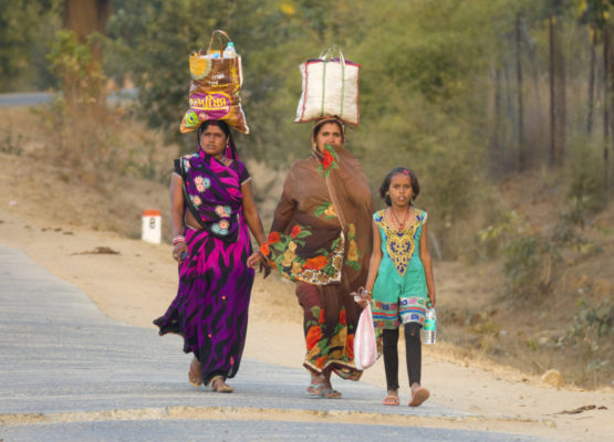Family members a taking food to their husbands  who are the master weavers in Madya Pradesh.   Suicide rates are very high.  The middle men pay very little but reap huge profits that never reach the weavers.